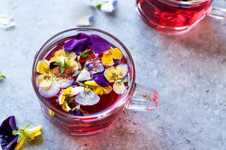 Red Herbal Tea with Edible Flowers. Organic Beverage.