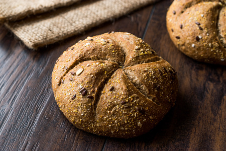 Freshly Baked Whole Wheat Grain Kaiser Roll Round Breads with Sack. Traditional Bakery
