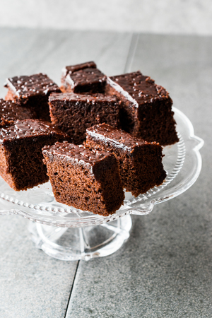 Homemade Moist Chocolate Sponge Cake Brownie Pieces in Vintage Glass Dessert Stand. Organic Food.