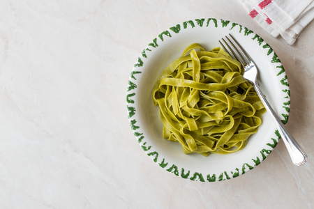 Italian Pasta Spinach Fettuccine served with Plate Ready to Eat / Tagliatelle. Traditional Food.