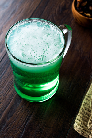 Glass of Green Beer for St Patrick's Day. Traditional Beverage.