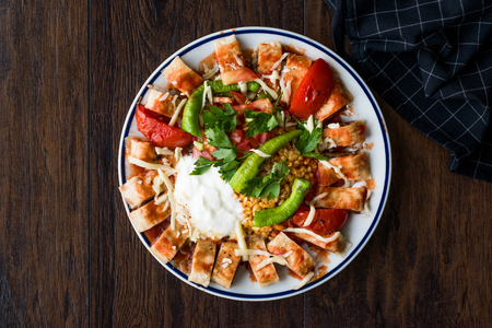 Turkish Food Beyti Kebap  Shawarma Kebab with Yogurt. Traditional Food with Minced Meat. Stock Photo