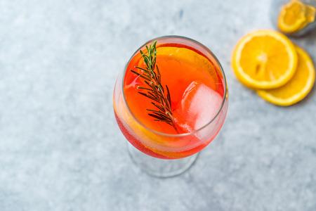 Aperol Spritz Cocktail with Orange Slice, Rosemary and Ice. Alcoholic Beverage. Stock Photo