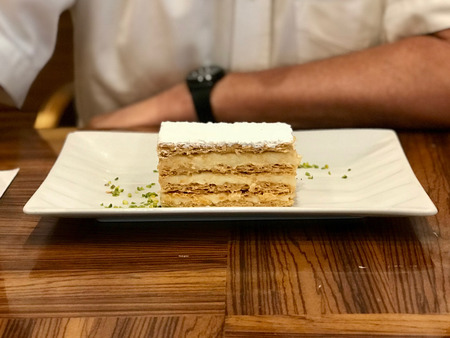Mille Feuille Layer Cake with Cream Served at Restaurant. Dessert Concept. 스톡 콘텐츠