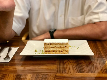Mille Feuille Layer Cake with Cream Served at Restaurant. Dessert Concept. Stok Fotoğraf