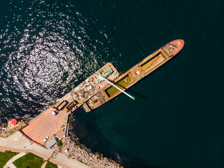 Aerial Drone View of Old Garbage Scow Vessel Ship with Crane in the Port. Transportation