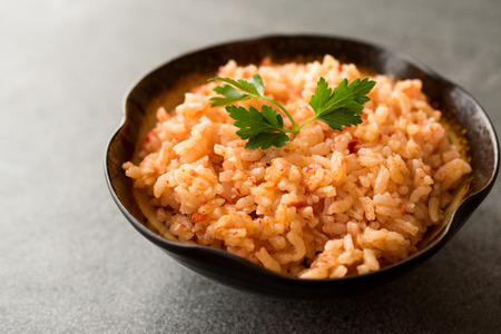 Homemade Tomato Rice with Parsley in Ceramic Bowl / Pilav / Pilaf. Traditional Organic Food.
