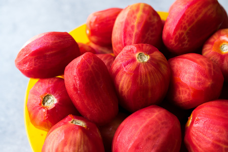 Whole Peeled Tomatoes in Yellow Bowl. Organic Food.