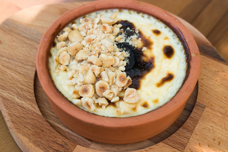 Turkish Dessert Rice Pudding Sutlac with Hazelnut Powder. Traditional Food.