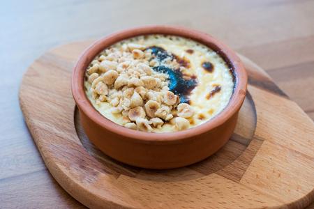 Turkish Dessert Rice Pudding Sutlac with Hazelnut Powder. Traditional Food.