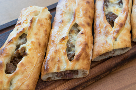 Turkish Bafra Pide with Minced Meat Kavurma Salad and Pickles. Traditional Food. Stock Photo