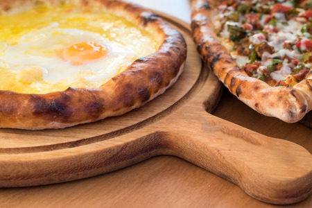 Turkish Round Pide with Fried Egg and Cheese. Traditional Food.