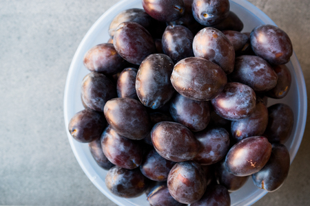 Damson Plums in Plastic Bowl. Organic Food.