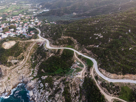 Aerial Drone View of Mountain Way with Sea Waves and Rocks in a forest