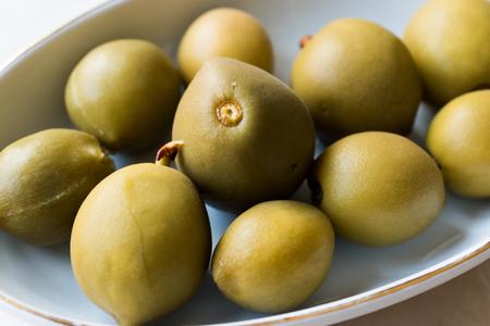 Pickled Unripe Green Almond Pickles in Plate  Cagla Badem. Organic Food.