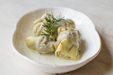 Pickled Artichoke Hearts with Rosemary Marinated in Plate. Organic Food.