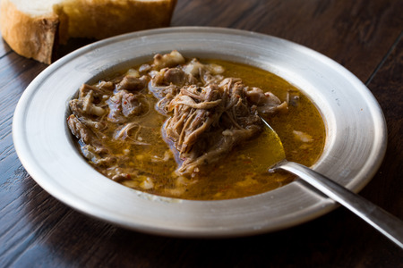 Turkish Soup Beyran with Lamb Meat, Rice, Chopped Garlic and Vinegar Sauce Served with Salad. Traditional Organic Food. 版權商用圖片