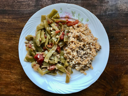 Turkish Food Green Beans with Olive Oil / Zeytinyagli Fasulye with Bulgur Rice Pilav or Pilaf. Traditional Organic Food. Stok Fotoğraf - 107861360