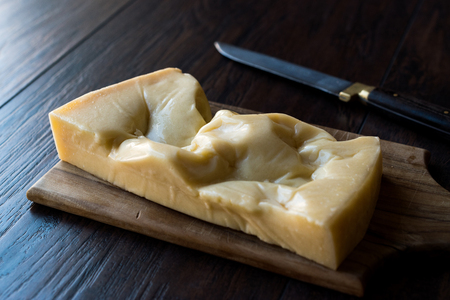 Turkish Traditional Gravyer  Gruyere Cheese From Kars on Wooden Surface. Organic Food.