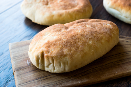 Asian Gua Bao Bun Pita Bread on Wooden Surface. Traditional Organic Food.