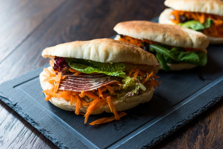 Taiwans Pita Bread Bun Sandwich Gua Bao with Smoked Bacon, Carrot Slices and Greens from Asia. Traditional Organic Food.