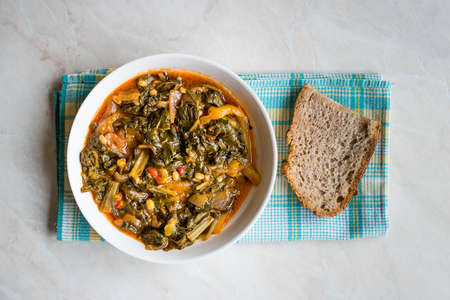 Homemade Healthy Chard with Rice, Onions and Tomato Paste / Turkish Food Pazi. Traditional Organic Food. Stock Photo