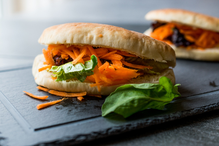 Vegan  Vegetarian Pita Bread Bun Sandwich Taiwans Gua Bao with Carrot Slices and Greens from Asia. Traditional Organic Food. Stock Photo