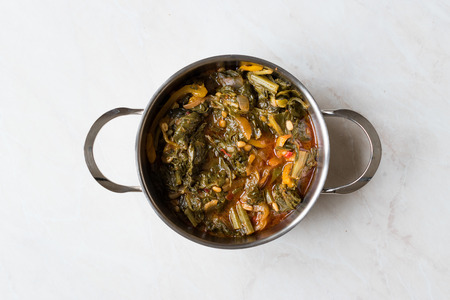 Homemade Healthy Chard with Rice, Onions and Tomato Paste in Metal Pot  Turkish Food Pazi. Traditional Organic Food.
