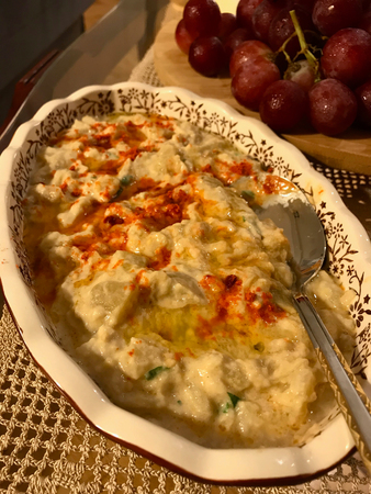 Homemade Hummus with Roasted Aubergine  Eggplant with Fried Butter Sauce and Red Pepper Powder. Traditional Organic Food. Stock Photo