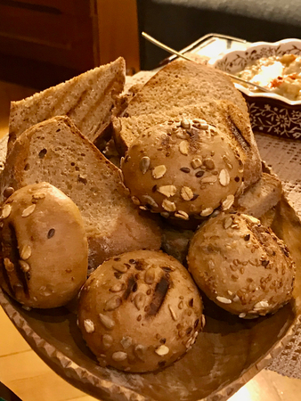 Fresh Homemade Rye Breads in Wooden Bowl. Organic Food.