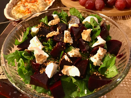 Homemade Beetroot Salad with Goat Cheese, Arugula and Sesame Seeds in Glass Bowl. Organic Food. Stock Photo