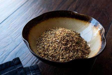 Dried Elderflower (Sambucus) / Dry Elderberry in Ceramic Bowl. Organic Product.