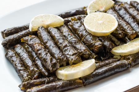 Stuffed Grape leaves with olive oil and Lemon / Zeytinyagli Yaprak Sarma Dolma. Traditional Organic Food.