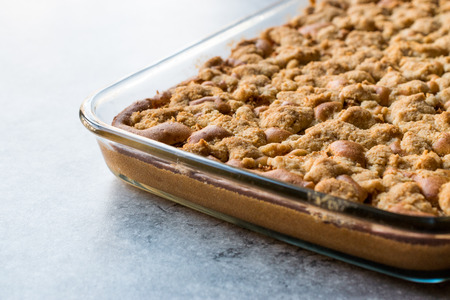 Homemade Whole Crumble Cake in Glass Bowl. Freshly Baked. Organic Dessert.