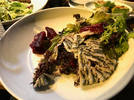 Anchovy with Black Rice  Hamsi Pilav or Pilaf served with Salad. Traditional Organic Food. Stock Photo