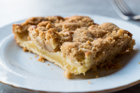 Homemade Apple Crumble Cake Slice with Fork. Organic Dessert.