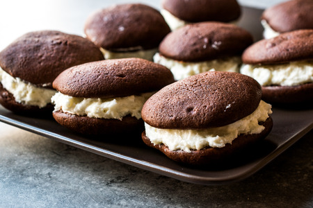 Homemade Chocolate Whoopie Pies Filled with Vanilla Butter Cream. Dessert Concept.