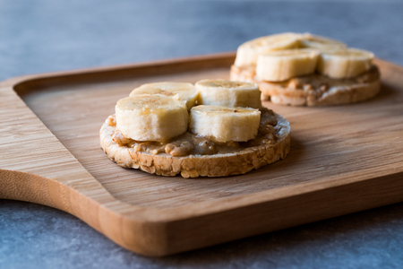 Bulgur Rice Cakes with Sliced Bananas and Peanut Butter / Round Crackers. Organic Healthy Snacks.