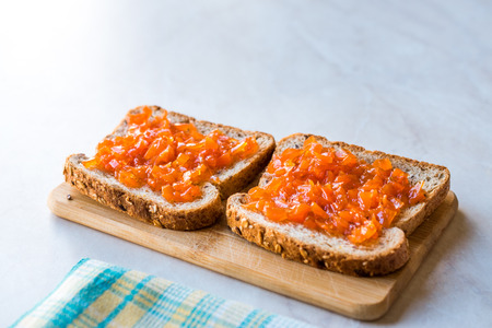 Carrot and Rose Jam on Bread  Mixed Marmalade. Organic Food for Breakfast.