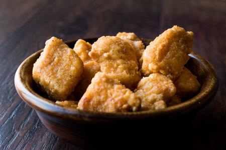Boneless Chicken Wings in Wooden Bowl  Nuggets. fast food.