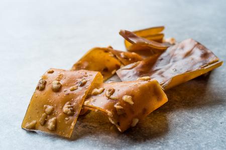 Turkish Pestil / Dried Fruit Pulp with Sesame and Walnut / Churchkhela. Traditional Organic Food. 스톡 콘텐츠