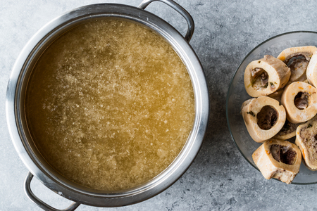 Bone Broth Bouillon in Metal Pan. Organic Food. 스톡 콘텐츠