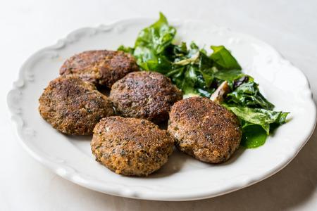 Homemade Salmon Meatballs Served with Orange Salad. Fast Food.