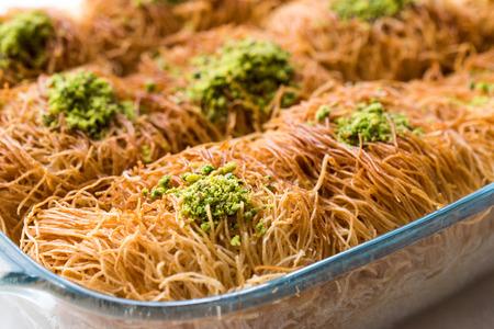 Homemade Turkish Dessert Fincan Kadayif Baklava  Baklawa with Pistachio Powder. Traditional Food.