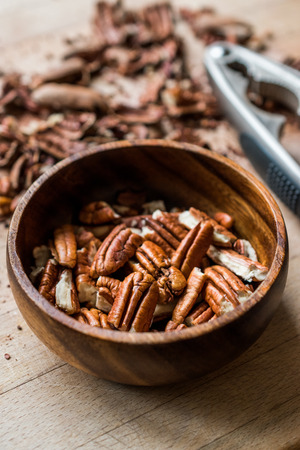 Peeled Pecan Nuts in Wooden Bowl without Shell  Walnuts. Organic Food.