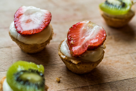 Mini Tarts, Tartolet or Tartlets with Strawberry, Cream and fresh fruits. Dessert Concept.