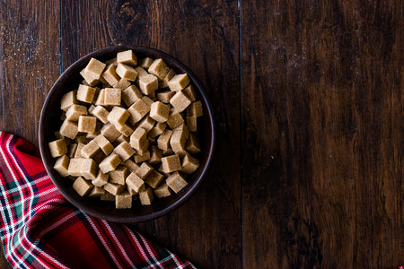 Raw Organic Brown Sugar Cubes in Wooden Bowl Ready to Eat. Food Product. Stock Photo