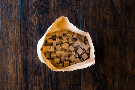 Package of Raw Organic Brown Sugar Cube in Craft Paper Ready to Eat. Food Product. Reklamní fotografie