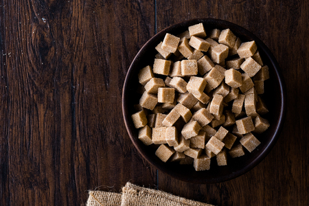 Raw Organic Brown Sugar Cubes in Wooden Bowl Ready to Eat. Food Product. Stock fotó