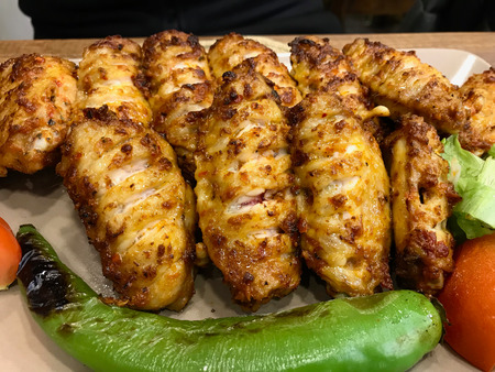 Turkish Style Spicy Chicken Wings Kebab  Kebap served at Restaurant. Traditional Recipe